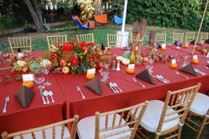 Big centerpiece with candles, pumpkins and branches